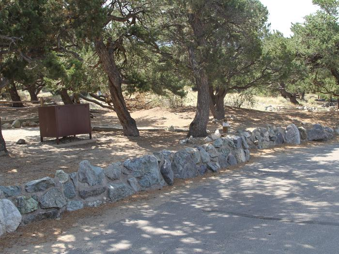 View of Site #23 parallel parking area, stairs, designated tent pad, and bear box.Site #23, Pinon Flats Campground