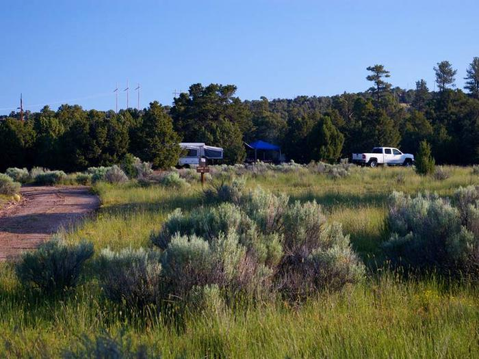 Truck, tent trailer and pop-up canopy in a campsite.Arch Dam Campground