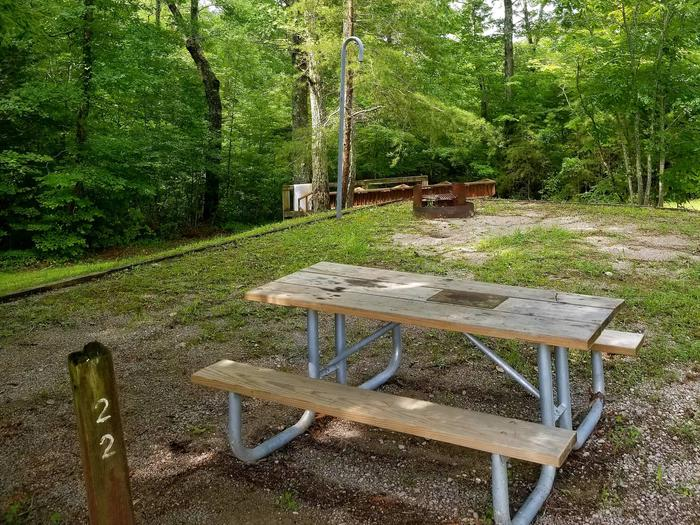 Picnic table sits on gravel tent pad with fire ring and lantern post.Site 22 Bear Creek Horse Camp