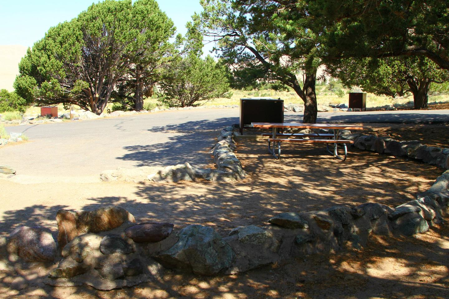 Back view of Site #68 tent pad, with picnic table and bear box.Site #68, Pinon Flats Campground