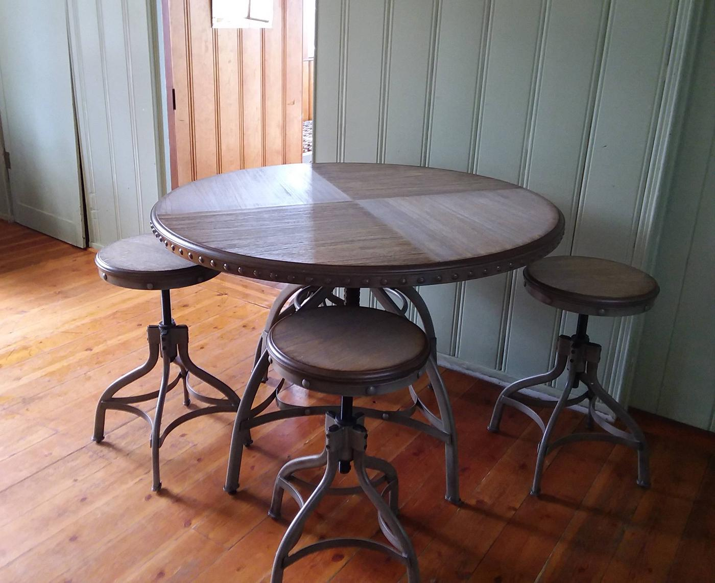 Dining table and chairs.Stylish table and bar stools accent the dining area in the cabin.
