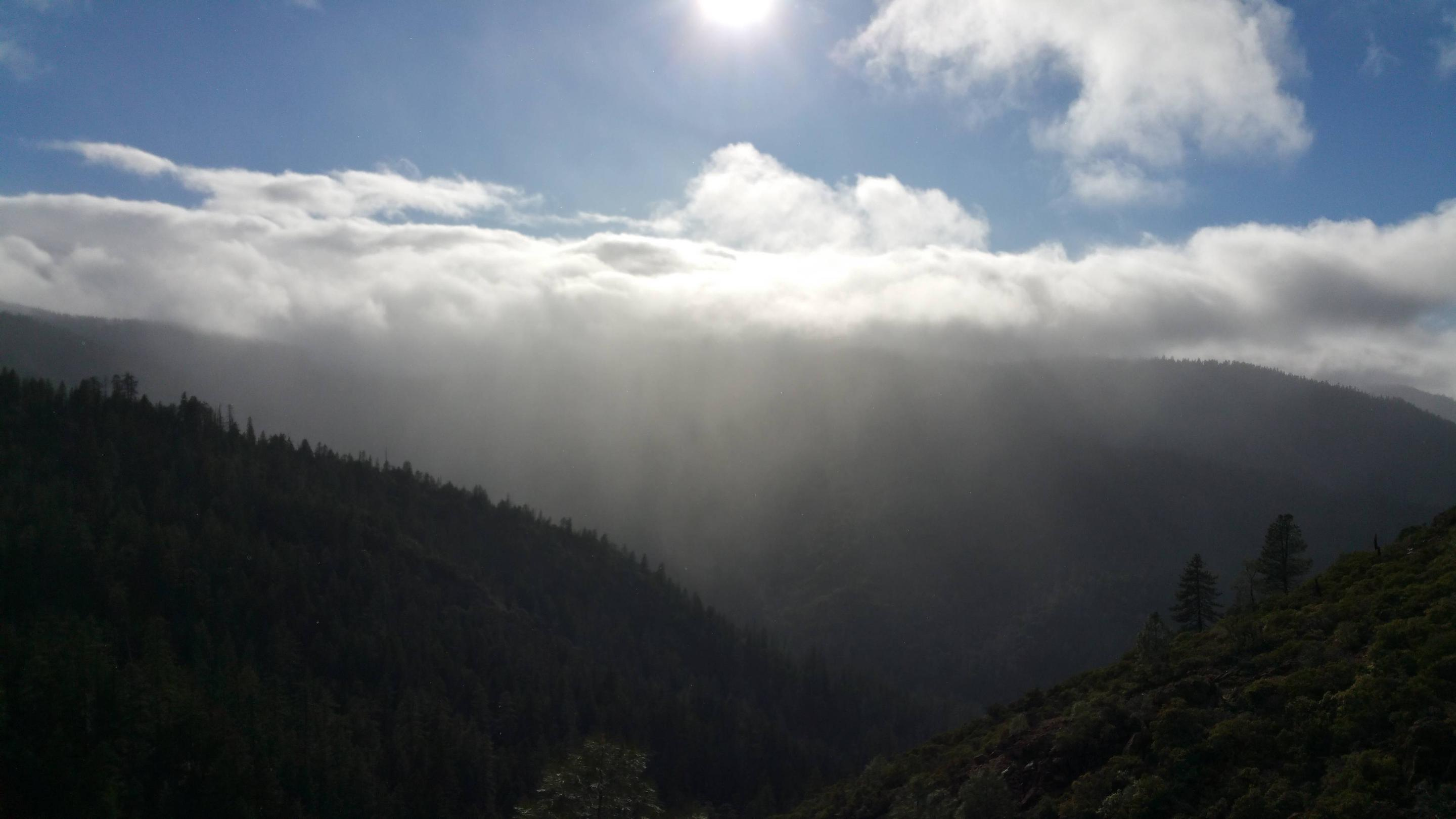View of mountains, clouds, sun.One of the many beautiful views guests might see on the way to the cabin.