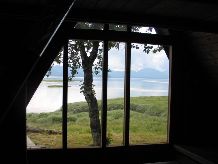 View of ocean and mountains outside Mallard Slough Cabin windowView from Mallard Slough Cabin