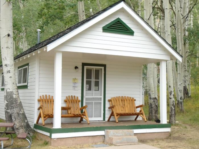 White cabin in aspen forestWarner Lake Cabin in the La Sal Mtns.