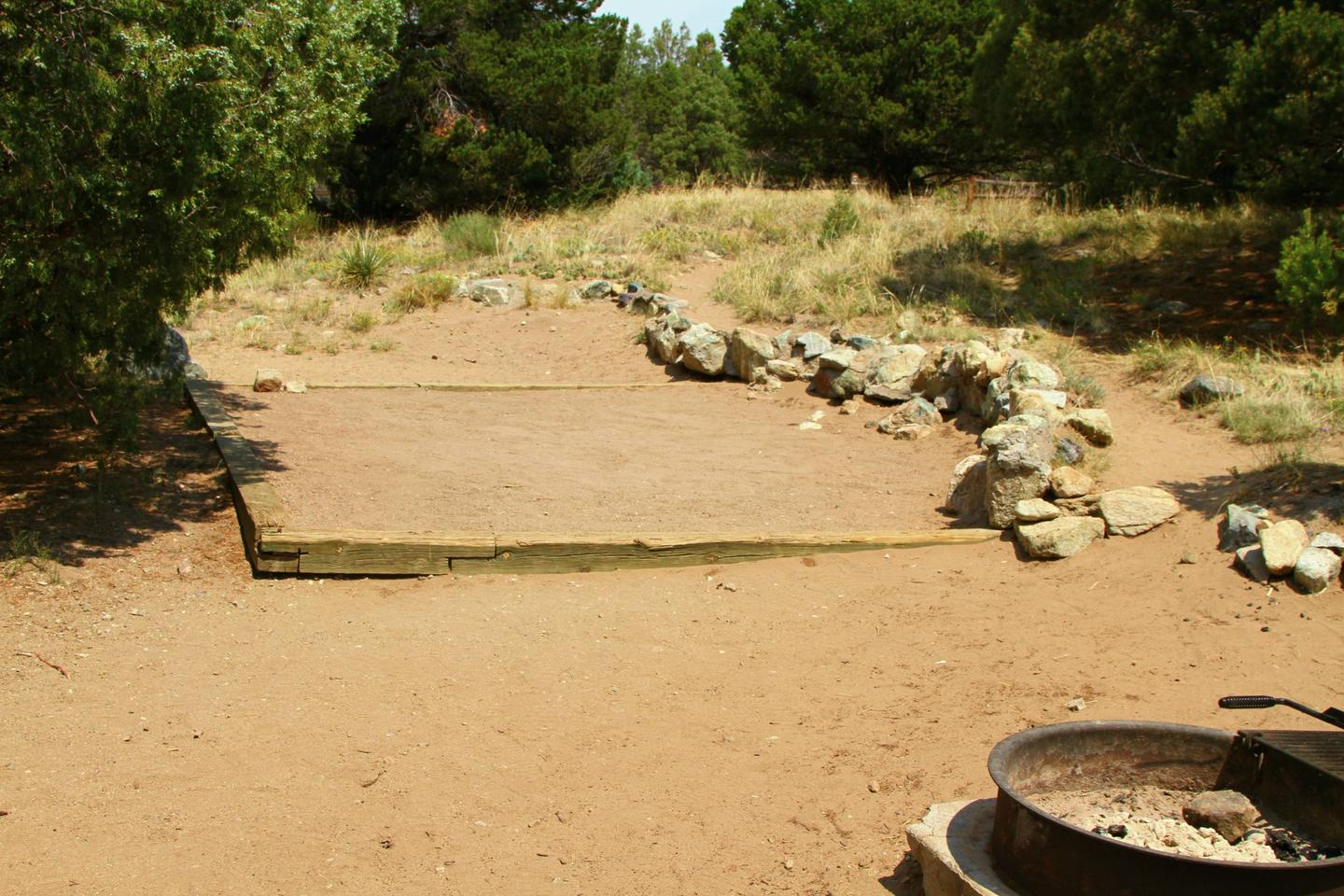 View of Site #84 designated tent pad. Shows proximity to fire ring.Site #84, Pinon Flats Campground