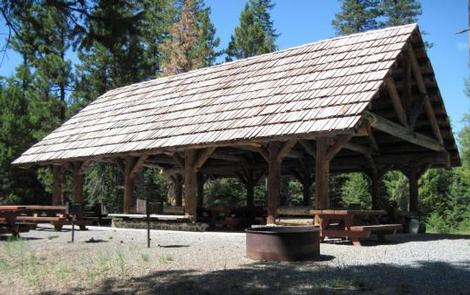 MAGONE LAKEFire ring and picnic tables in front of large picnic shelter