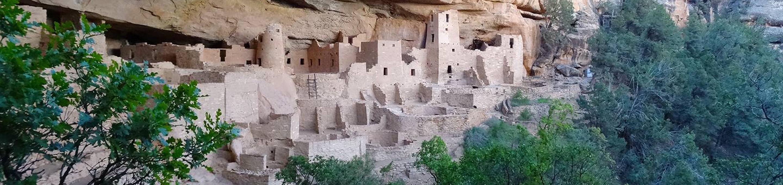 Village of ancient stone masonry seen through the treesCliff Palace