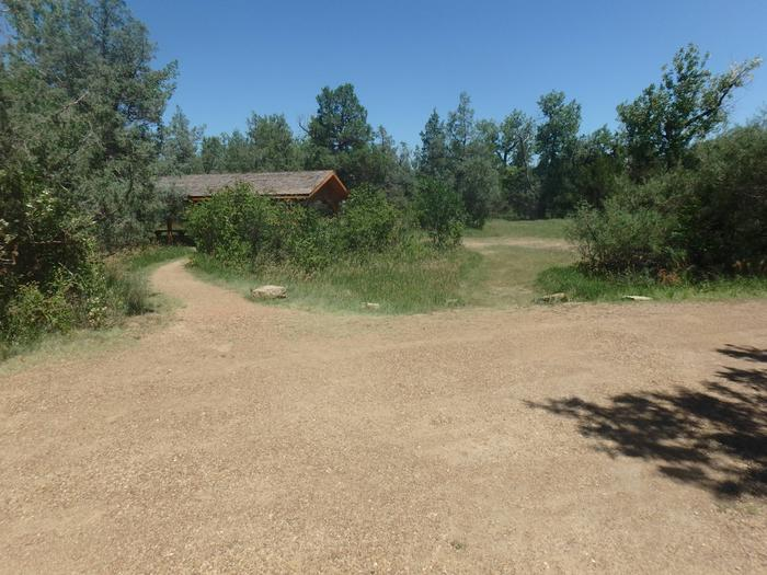 Site 25 (Group) has a picnic shelter located a short distance from the gravel pad. A picnic shelter with several picnic tables are provided.