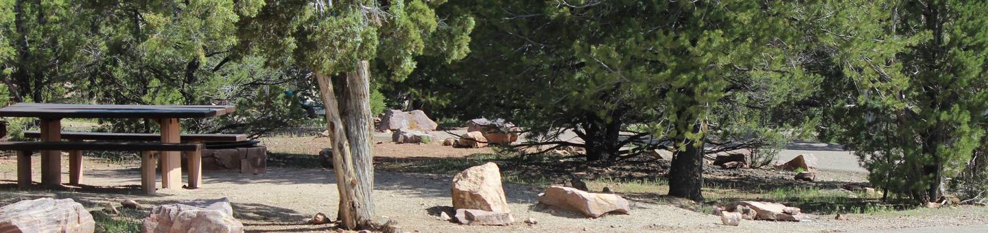 This site has a picnic table that is located in a bunch of cedars. Big boulders surround the picnic area to keep vehicles outside the parameter.Cedar Springs Campground: Site 1