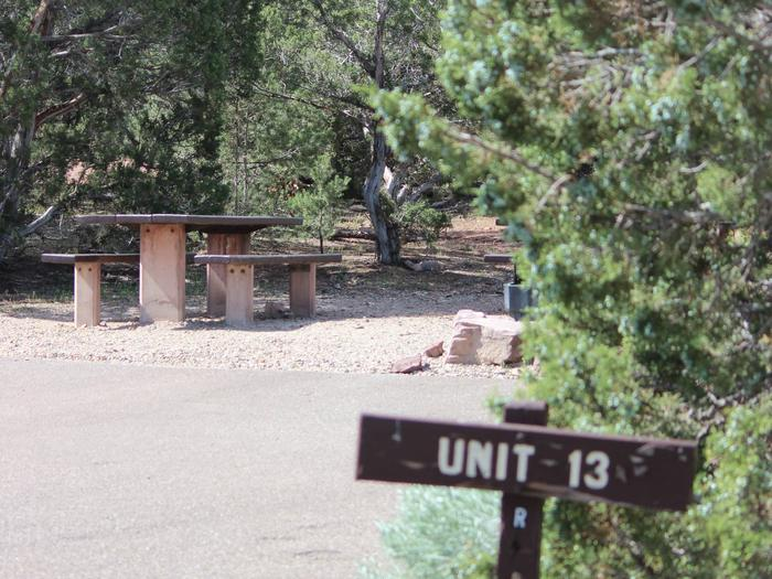 This site has a picnic table that is located in the trees behind the asphalt parking area.Cedar Springs Campground: Site 13