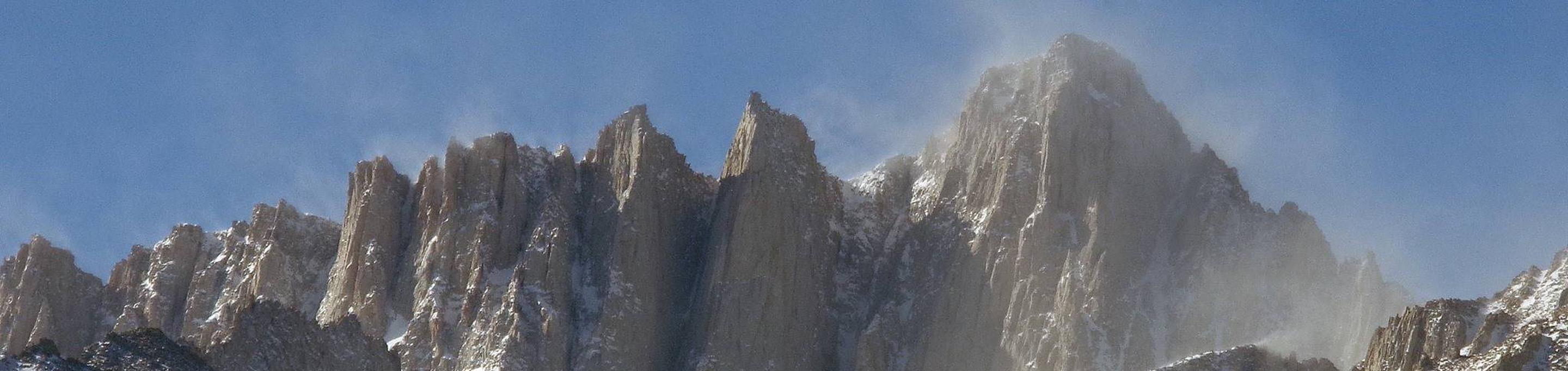 Wind blows snow from the summit of Mount Whitney.The beautiful veil of snow blowing from the summit also indicates the extreme conditions that may be encountered on Mount Whitney.