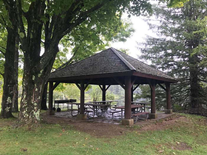 Pavilion with picnic tables in wooded areaPavilion 1