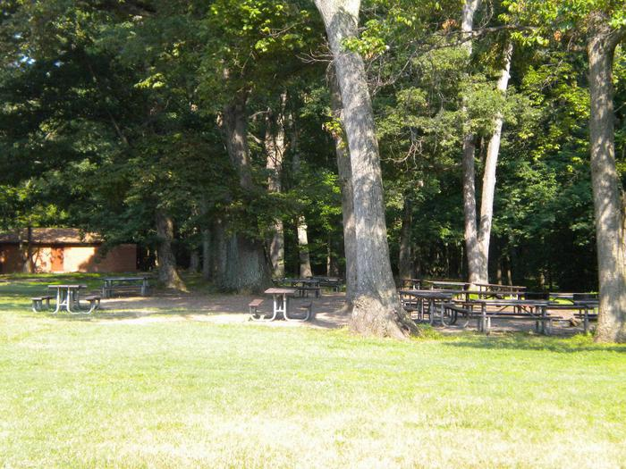 Photo of picnic tables and restroom in Picnic Area CPicnic Area C  has restroom located in the area, the tables are under the trees
