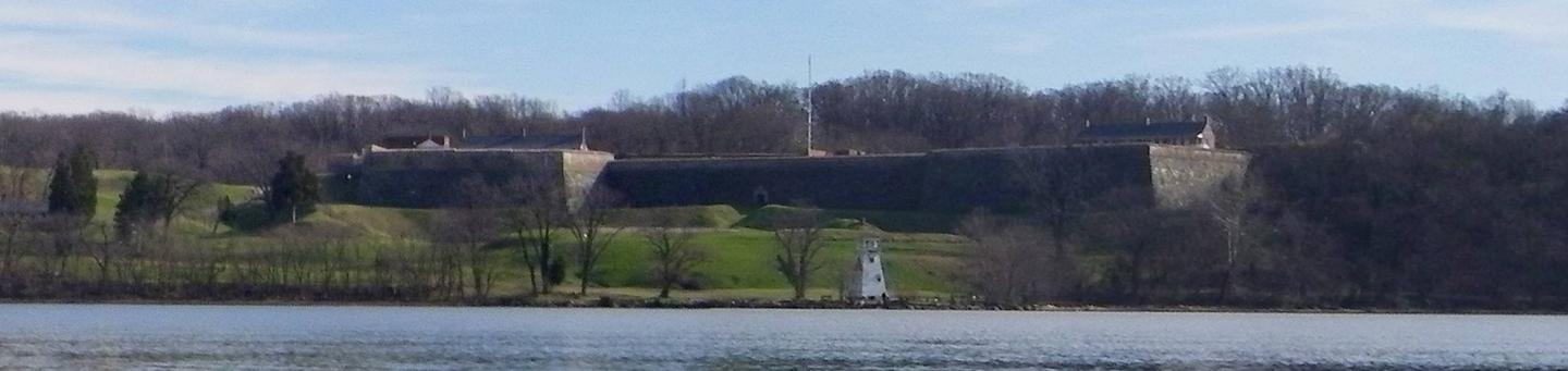 Photo of Historic Fort Washington and Lighthouse with Potomac River in foregroundFort Washington and the Lighthouse from the Potomac River