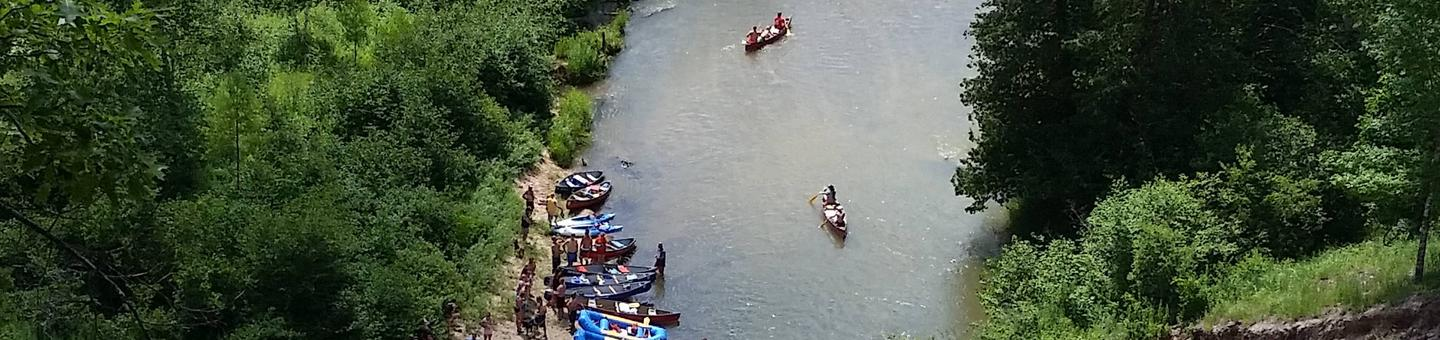 Canoes and other watercraft make their way down the Wild and Scenic Pine RiverPine River