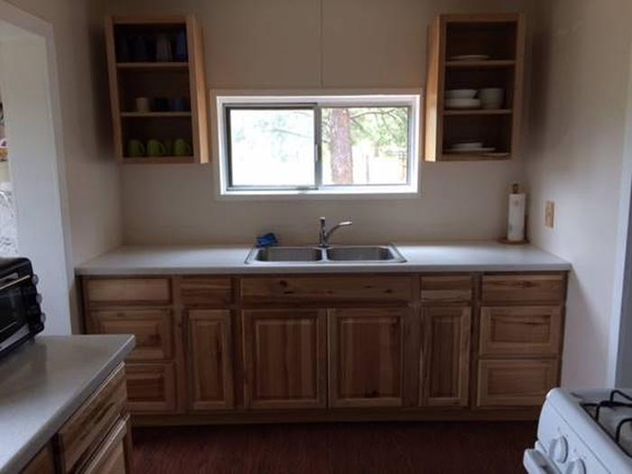 Main cabin kitchenFull kitchen with gas range, microwave, toaster oven.