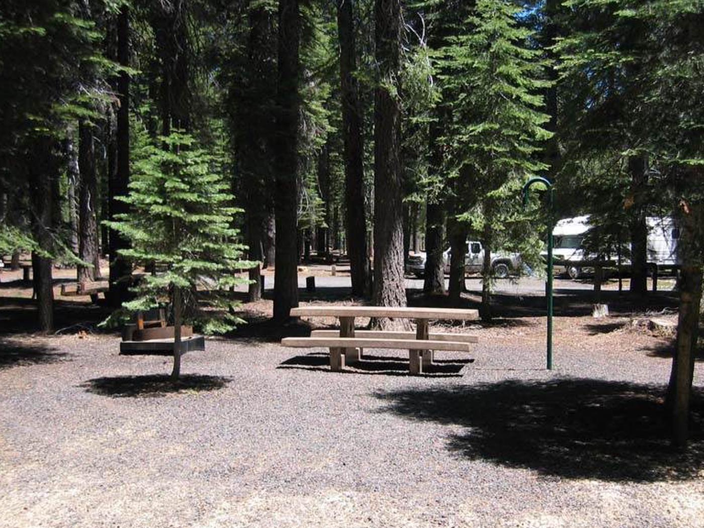Accessible site at Horse Camp, featuring concrete table, fire ring and grill, and lantern postHorse Camp accessible campsite
