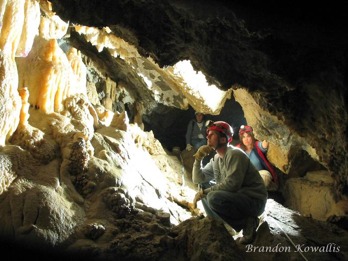 Cavers study formations deep in the caveIntroduction to Caving Tour