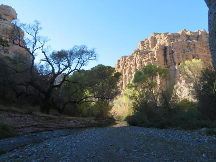 Aravaipa Canyon Wilderness from the East EntranceThe geology changes from the east side to the west. Rock layers on the east side are more easily eroded, which may be why the canyon is wider on the east. The hard bedrock schist on the west side has created a tighter, narrower canyon.