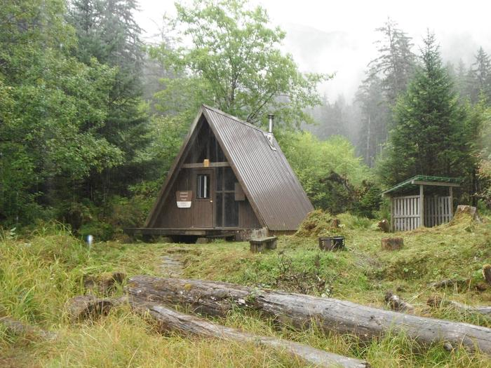 Garnet Ledge Cabin surrounded by trees.Garnet Ledge exterior