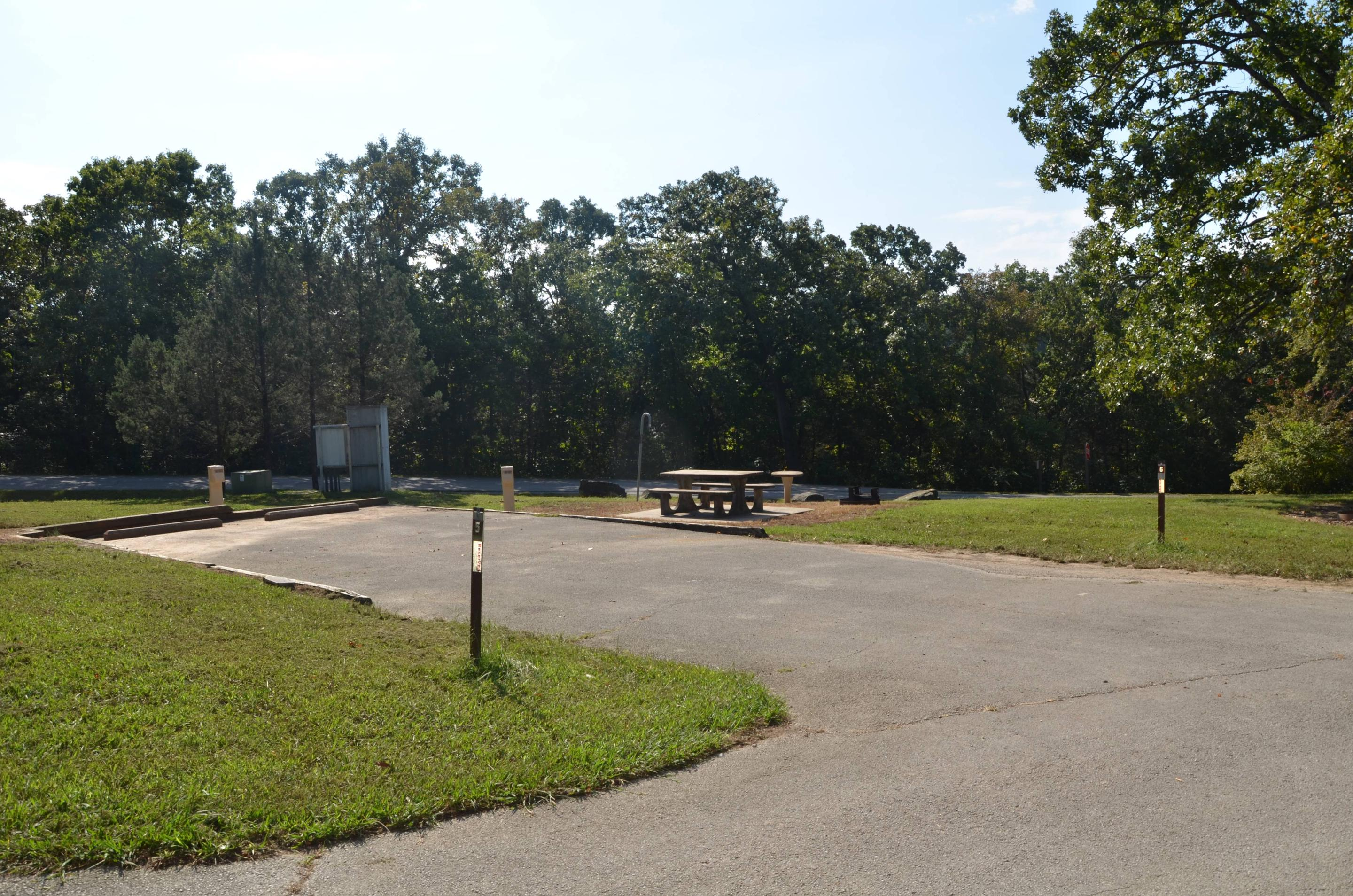 Aunts Creeksite 6 shares a parking area with site 5.