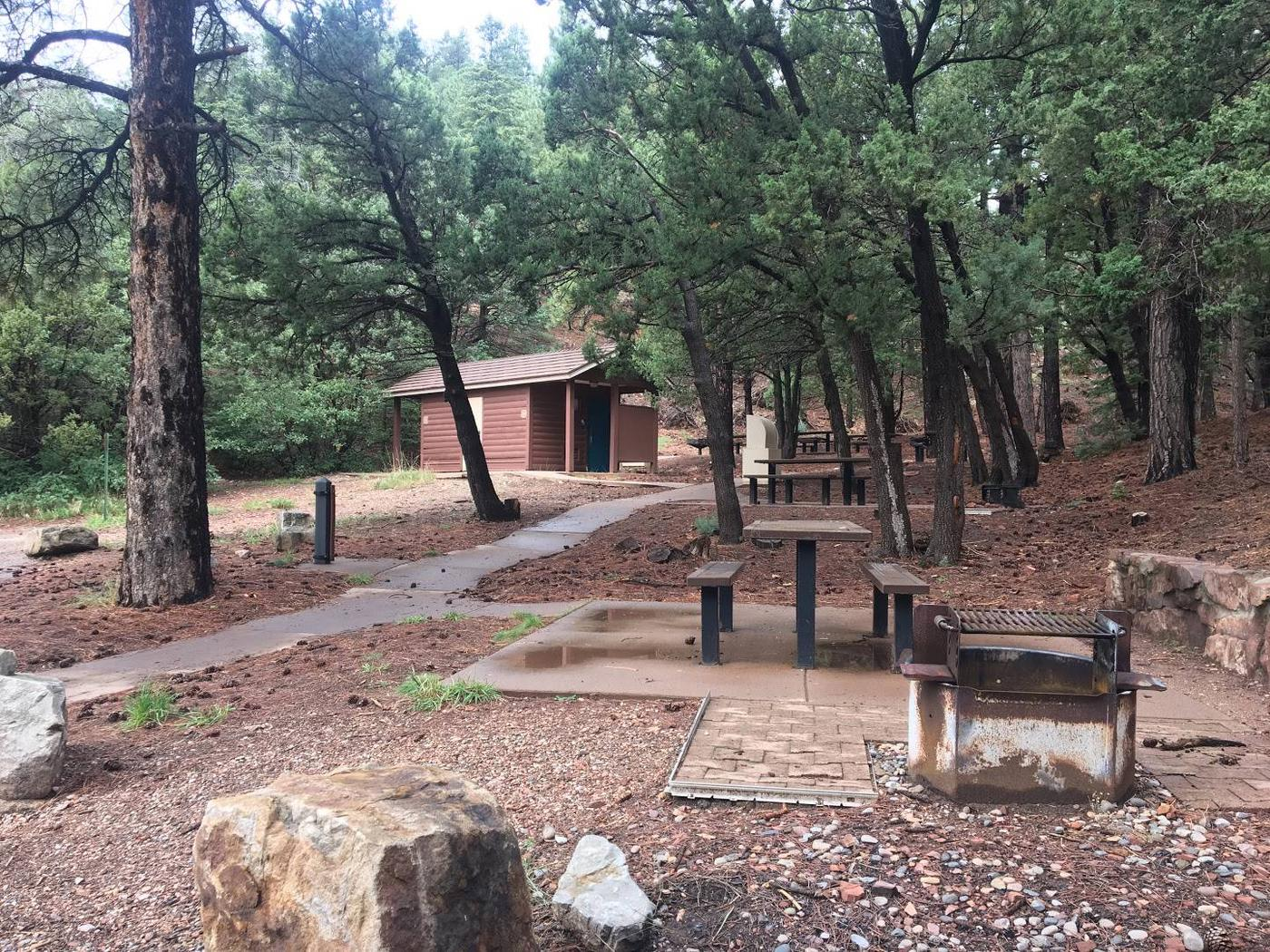 this is a large view picture of a portion of the group site with table girll and restroomPartial view of Cienega Group Site