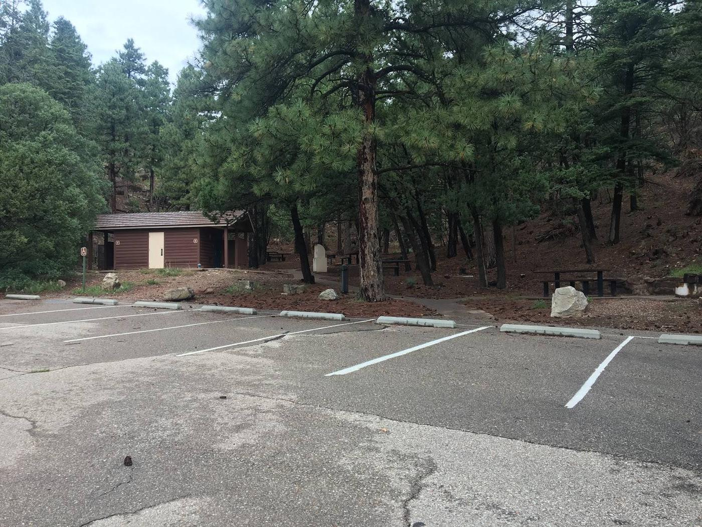 shows shaded picnic area for groups with restroom and parking lot close byShaded group picnic area with restroom and parking close by