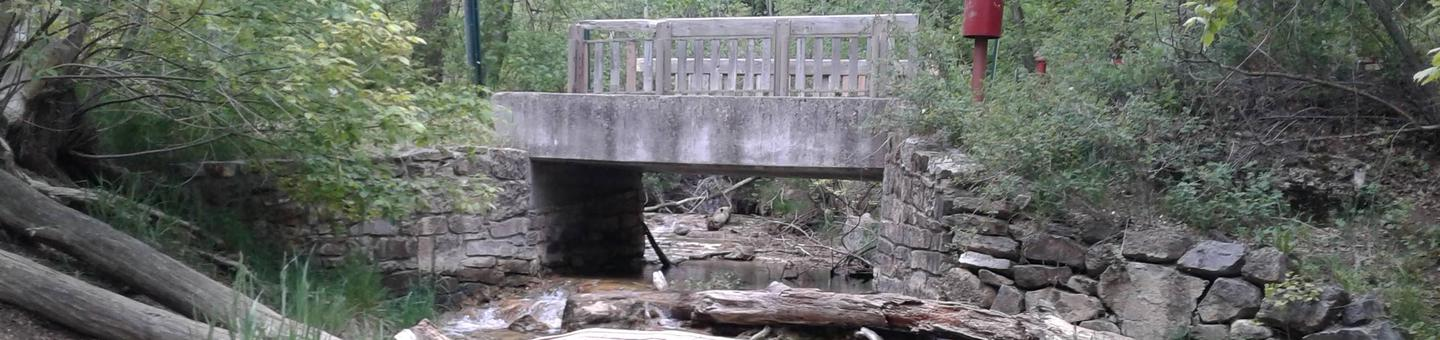 This is a picture of the stream and bridge at Las Huertas Stream and Bridge in Las Huertas Picnic Site