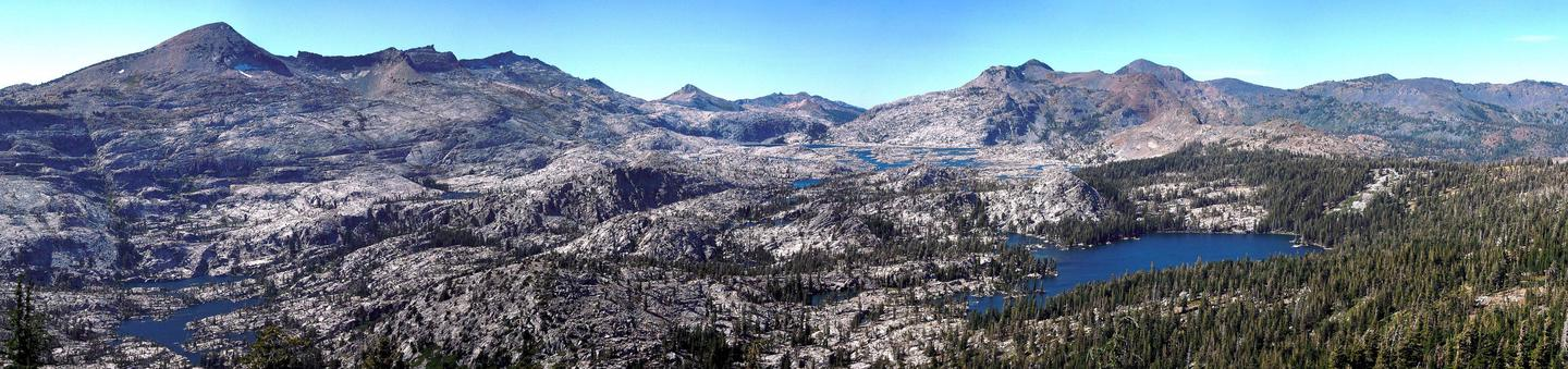 Granite mountain peaks with alpine lakes in foregroundView of Pyramid Peak and the Crystal Range in Desolation Wilderness.