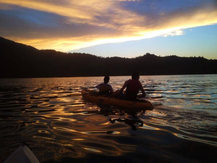 A tandem kayak on Whiskeytown lake in the late eveningWhiskeytown Moonlight Kayak
