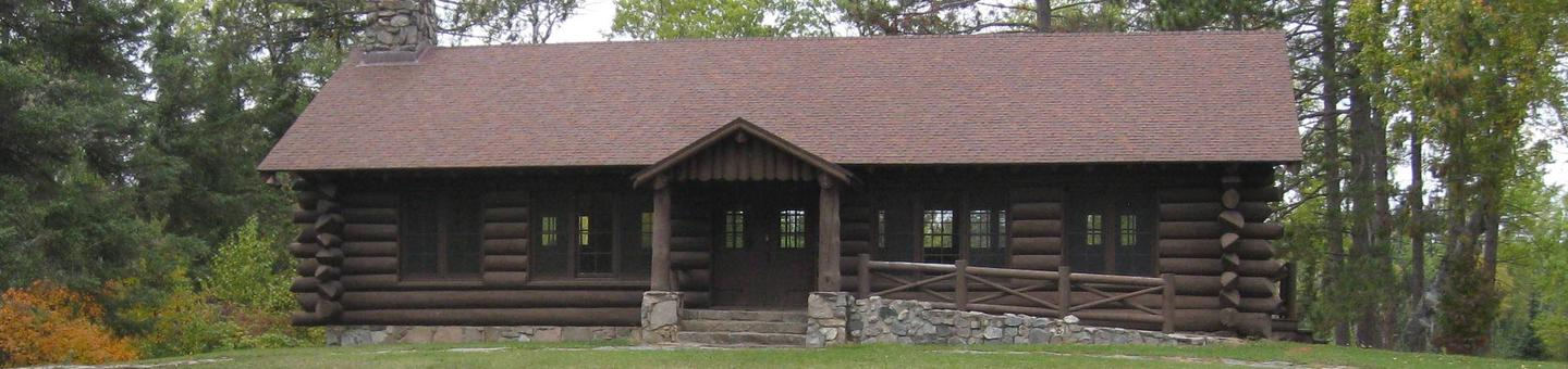 Picture of log building.Civilian Conservation Corp era log pavilion.  Pavilion is available for day-use via the reservation service.  Facilities include tables, electricity, outdoor grill and tables, and outhouse.