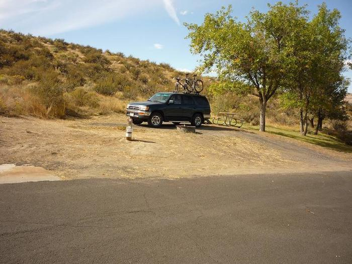 Open site with hill in back groundBack in gravel parking