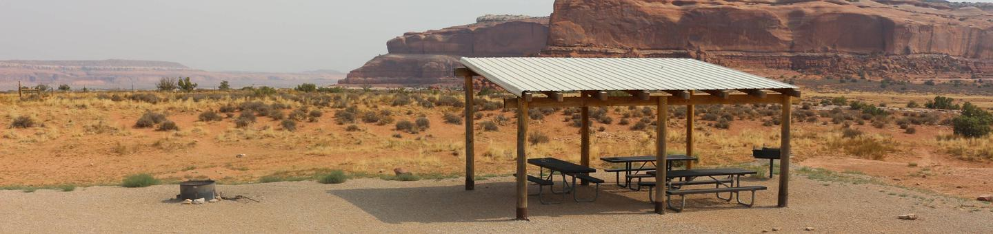 Lone Mesa Group Site B shade shelter and picnic tables.