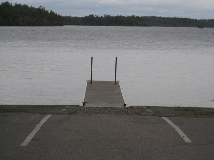 Picture of dock on a lake.Boatlanding containing dock, access ramps, canoe landing, and large parking area.