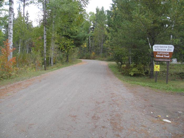 Picture of road with sign.Entrance to South Kawishiwi Campground, via gravel road.
