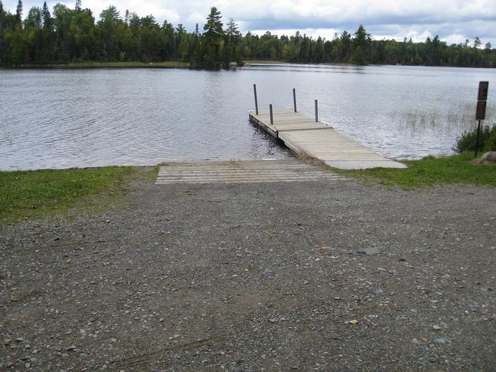 Picture of boatlanding.Boatlanding with dock and concrete boat ramp.  Area is located adjacent to small parking area.