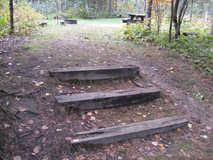 Picture of stairs leading to campsite.Stairs leading to table, fire ring, and tent pad.