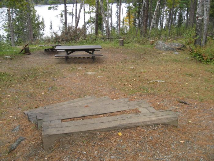 Picture of campsite, table, and steps.Campsite with table, fire ring, and tent pad.  Accessed via steps.
