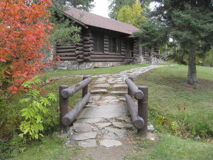 Picture of log building and access trail.Kawishiwi CCC-era log pavilion.  Accessed via bridge and rock path from main parking lot.