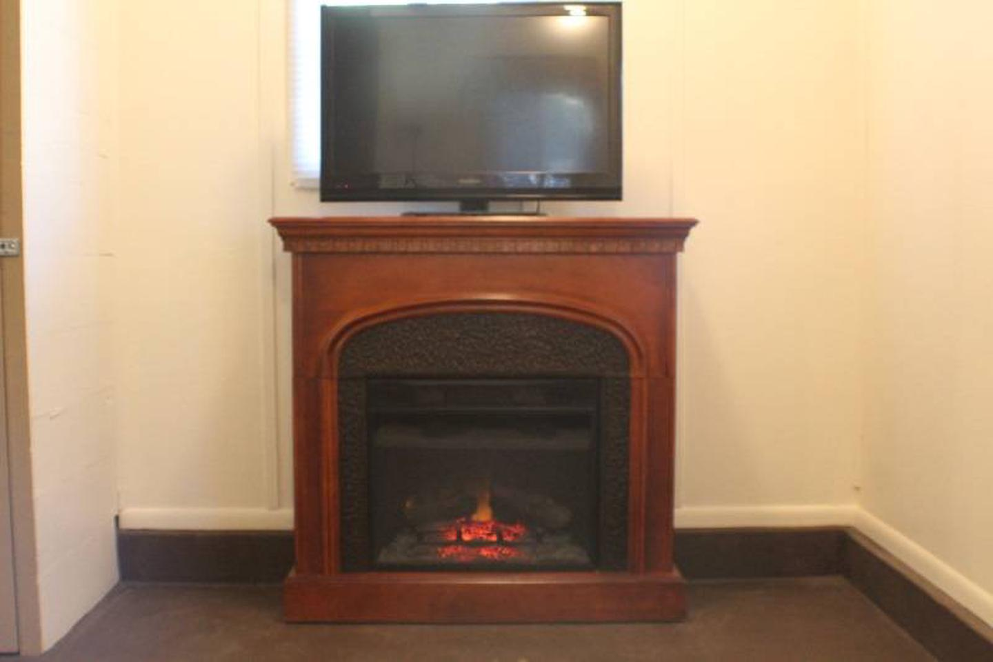 Electric Fireplace, TV w/DVD playerCabin 7: View to right of door showing electric fireplace, TV with DVD player.