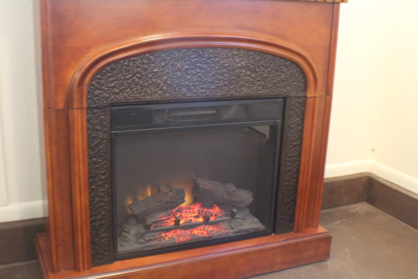 Electric FireplaceCabin 7 - Cozy electric fireplace can be run with or without heat.