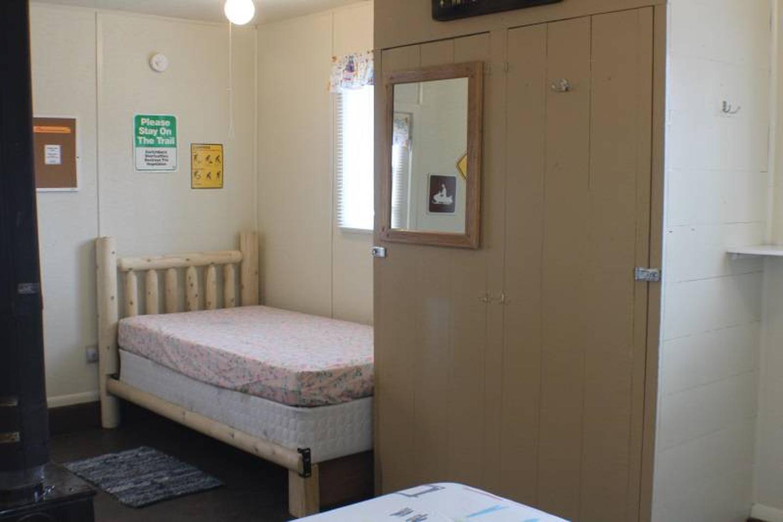 Twin bed to left of doorCabin 1: View to left of door showing twin bed.