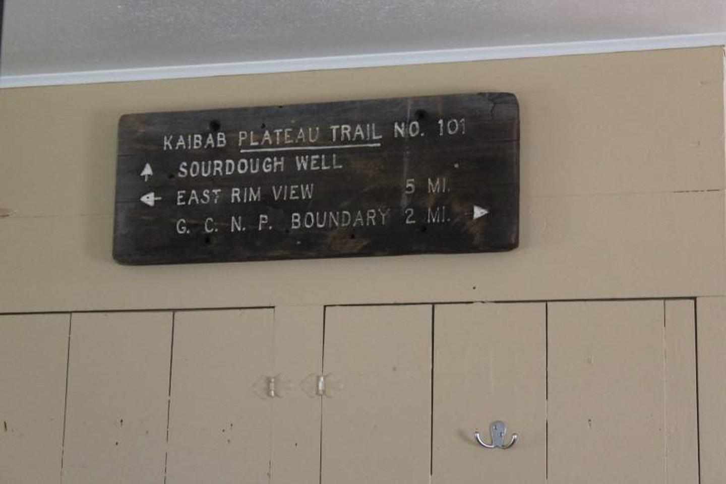 wall decorCabin 1: Recreation/Trails  Themed decor with actual trail signs.