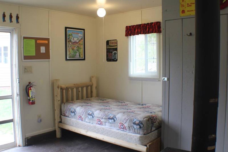 twin bedCabin 4: View to left of door showing twin bed.
