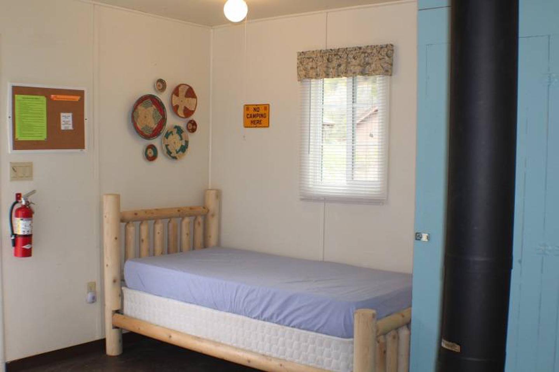 twin bedCabin 5: View to left of door showing twin bed.