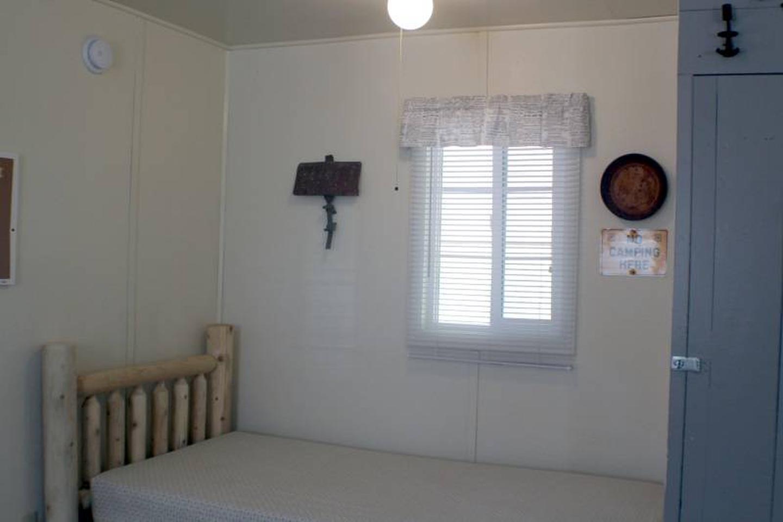 twin bedCabin 6: View to left of door showing twin bed.