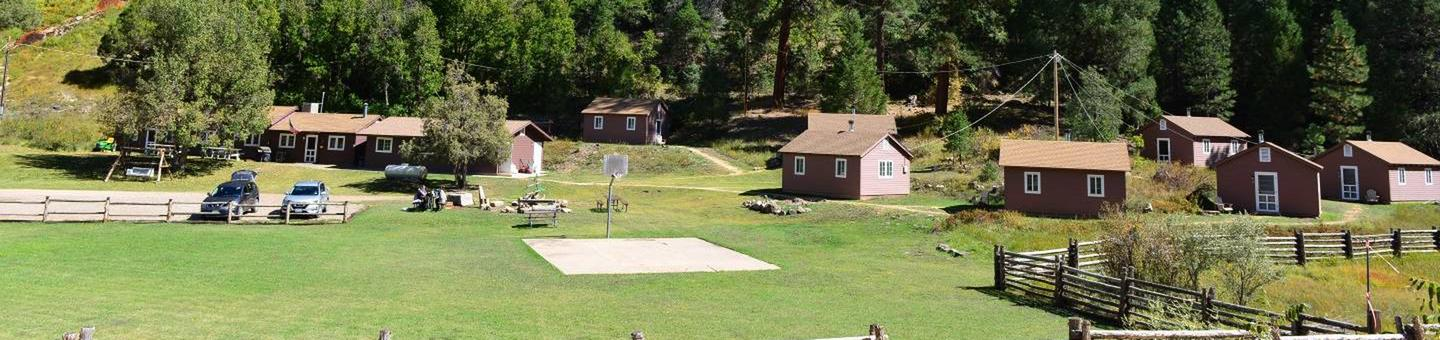 Site photo showing all cabins and common areasBig Springs Cabin Site is nestled in the Ponderosa Pines on the Kaibab National Forest near the north rim of the Grand Canyon.