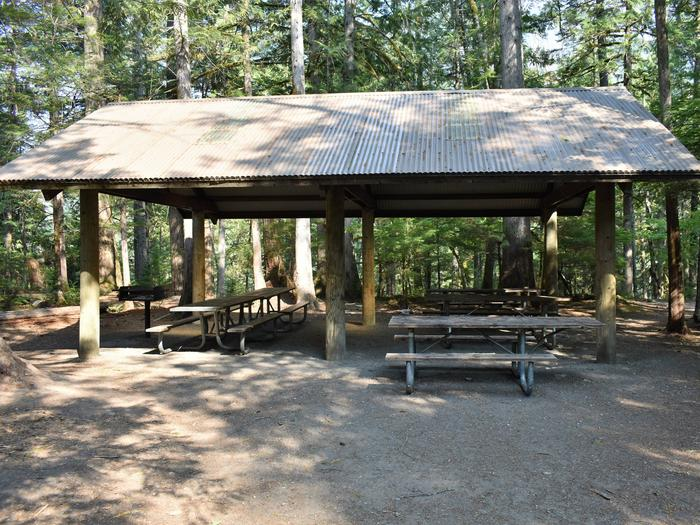 Picnic tables beneath group shelterView of group site A shelter
