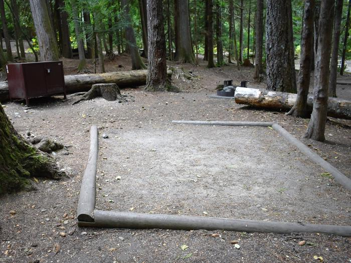 Food storage locker, tent pad, and fire ringView of campsite
