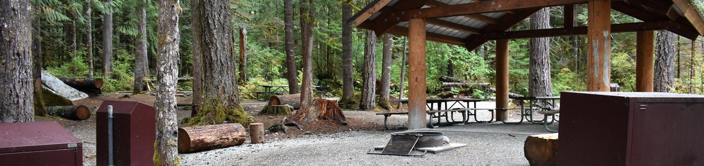 Shelter, fire rings, picnic tables, and food-lockersView of campsite